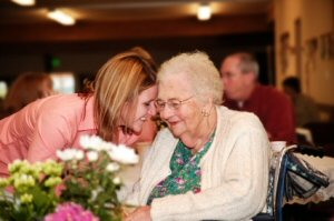 Grandma getting hug and flowers